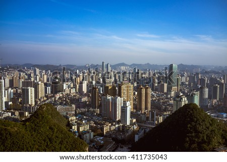 China urban cityscape. Skyscrapers and slums. Guiyang, Guizhou province. - stock photo