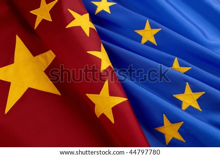 Chinese and European Union flags shot together, close-up - stock photo