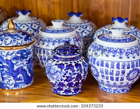 chinese antique vase on the wood background - stock photo