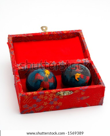 Chinese balls for massage, inside the red box - stock photo