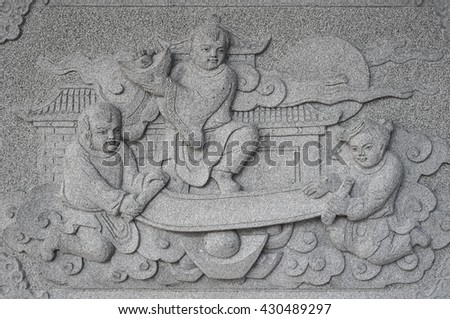 Chinese boys and girl marble carving wall, Decorative Chinese art style in Chinese public temple - stock photo