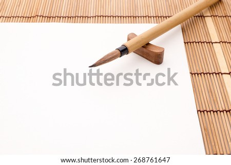Chinese brushes and white papers - stock photo
