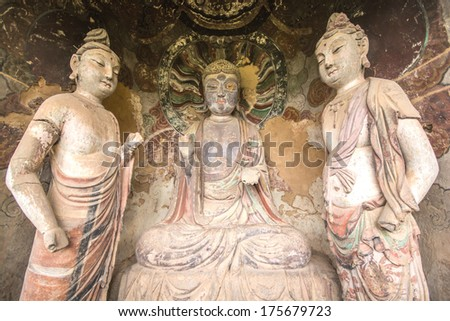 Chinese Buddha image in Maiji mountain grottoes,China. Located in Tianshui County, the Maiji Caves include 194 caves with more than 7,200 clay statues and stone carvings - stock photo