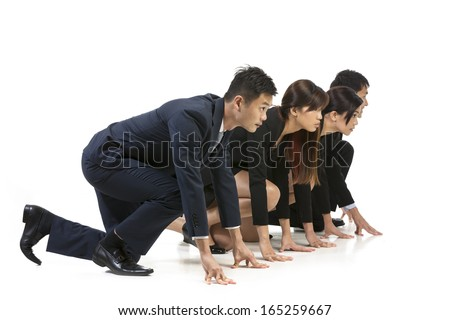 Chinese business team ready to start a race. Conceptual image about competition. Isolated on white background. - stock photo