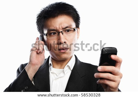 Chinese businessman serious expression when using video call, isolated on white background - stock photo