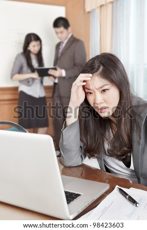 Chinese businesswoman looks depressed working in the office - stock photo