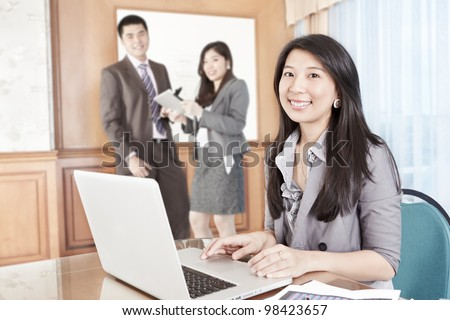 Chinese businesswoman working in the office - stock photo