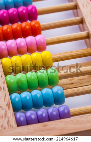 Chinese calculator with colorful beads - Close-up. Concept photo of business, child ,education , teaching ,learning, teaching, mathematics, arithmetic, accounting, calculate and calculating skills. - stock photo