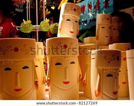 Chinese Carving Dolls with smiling - stock photo