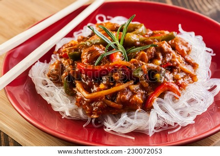 Chinese chicken with vegetables and rice noodles - stock photo