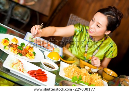 Chinese Cuisine Chinese girl are having lunch - stock photo