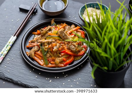 Chinese Cuisine - Pork with Vegetables Deep Fried in Sour-Sweet Sauce - stock photo