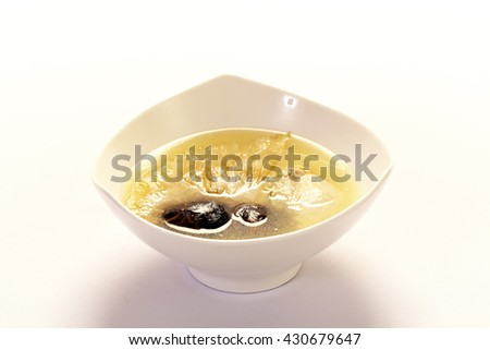 Chinese Dessert,lotus root and ginkgo nut in longan syrup on white background - stock photo