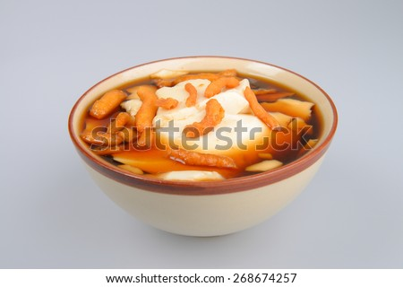 "Chinese dessert made with white tofu serve with brown sugar and ginger.Sprinkle with Deep-fried dough stick known as ""Patongo"" - stock photo"