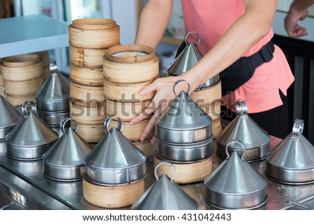 Chinese dim sum in bamboo steam containers (food) - stock photo