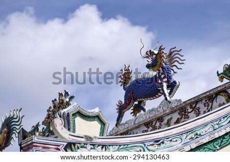 Chinese dragon-headed unicorn,horse, colorful horse, kilen, kylin, kirin - stock photo