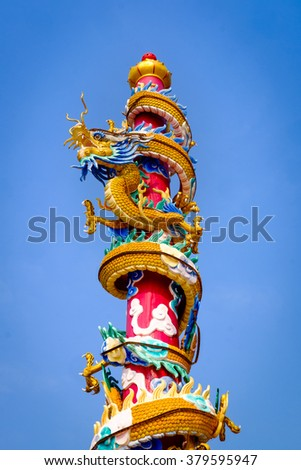Chinese dragon pole with blue sky - stock photo