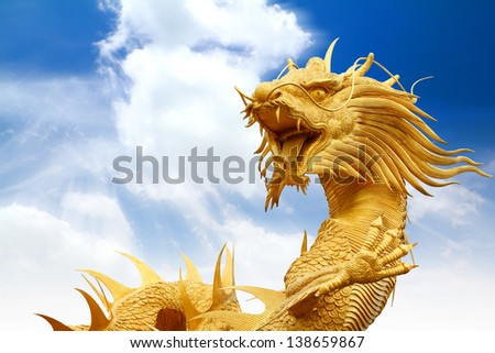 Chinese dragons statue with cloud and blue sky,clipping path. - stock photo