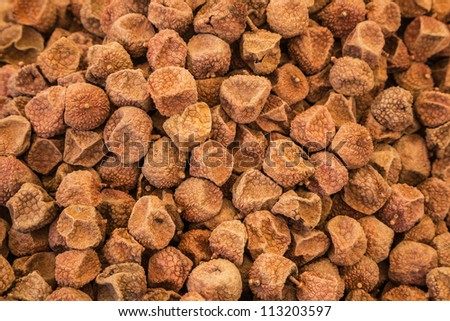 Chinese dried litchee stacked together in the market place - stock photo