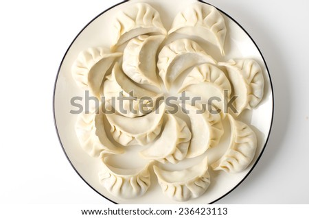 Chinese Dumplings on White Plate, White Background - stock photo