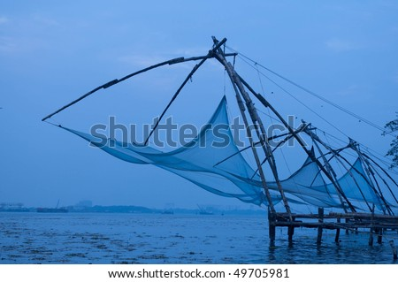 Chinese Fishing nets at fort Cochin on an overcast day - stock photo