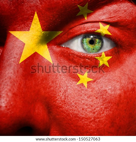 Chinese flag painted on a man's face to support his country China - stock photo