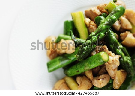 Chinese food, asparagus and chicken stir fried - stock photo