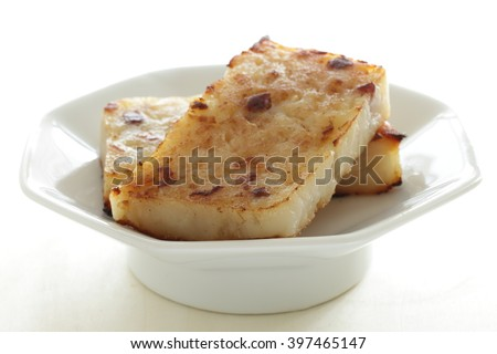 Chinese food, Cantonese cuisine Radish cake for New year Dim sum image - stock photo