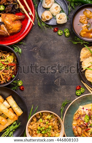 Chinese food dark background. Chinese noodles, fried rice, dumplings, peking duck, dim sum, spring rolls. Famous Chinese cuisine dishes set. Space for text. Top view. Chinese restaurant concept - stock photo