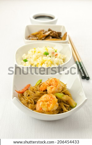 Chinese food dishesm cantonese rice, noodles, beef with bamboo - stock photo