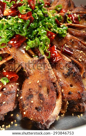 Chinese food - Duck head with chili pot - stock photo