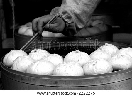 Chinese food of dumpling, and chinese people called it Jiaozi, they eat Jiaozi expressing meaning of lucky and happy - stock photo