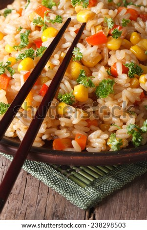 Chinese fried rice with eggs, corn and spices close-up on a plate, vertical  - stock photo