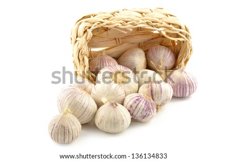 Chinese garlic (solo) in a basket on a white background - stock photo