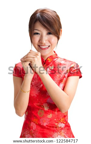 Chinese girl in traditional Chinese cheongsam blessing, isolated on white background - stock photo