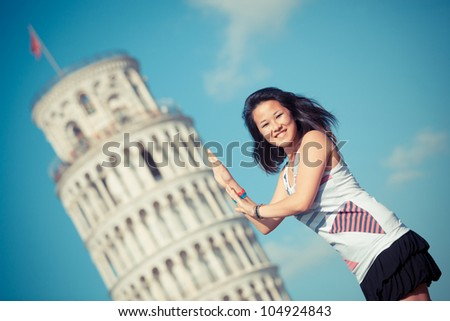 Chinese Girl with Leaning Tower of Pisa - stock photo