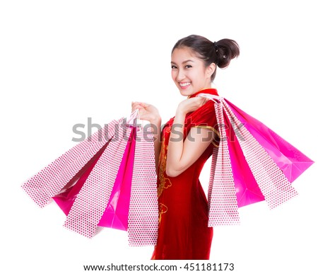 Chinese girl with qipao and shopping bag, white isolated background - stock photo
