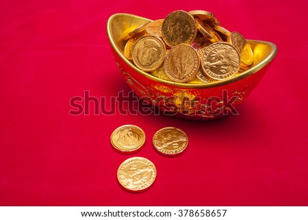 Chinese Gold ingot (Sycees, YuanBao ) are used a symbol of prosperity among Chinese people. representing a fortunate year to come. On red color background - stock photo
