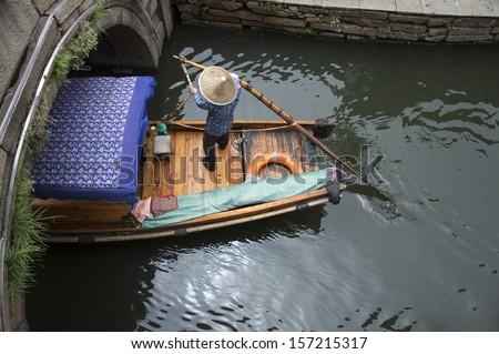 Chinese Gondola at Zhou Zhuang, water city, Shanghai, China - stock photo