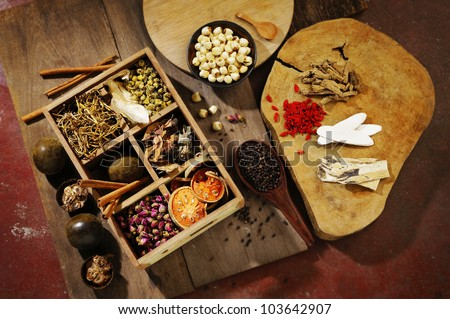 Chinese herbal medicine and flower tea on wooden - stock photo