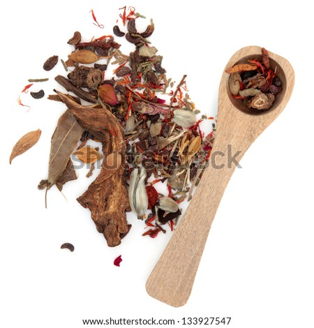 Chinese herbal medicine mixture with wooden spoon over white backgorund. - stock photo