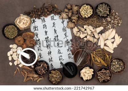 Chinese herbal medicine with acupuncture needles and asian script. Translation describes chinese herbal medicine as increasing the bodys ability to maintain body and spirit health and balance energy. - stock photo