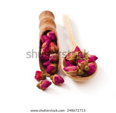 Chinese herbal rose tea in a scoop and spoon isolated on white background  - stock photo