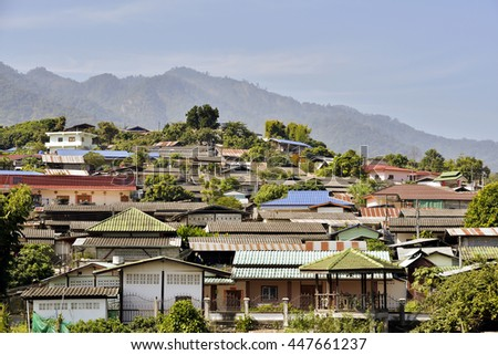 Chinese houses on hill at Santichon village, Pai city, Mae Hong Son Province, Thailand. - stock photo