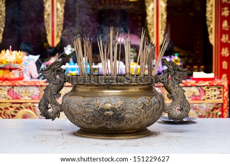 Chinese incenses in a buddhist temple in Bangkok Chinatown - stock photo