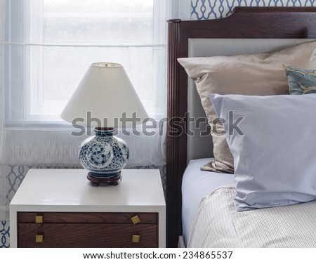 chinese lamp style on table side in luxury bedroom - stock photo