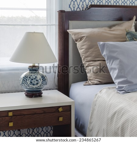 chinese lamp style on table side in luxury bedroom at home - stock photo
