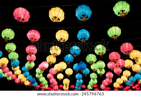 Chinese lanterns hanging in street at night during the Chinese New Year  - stock photo