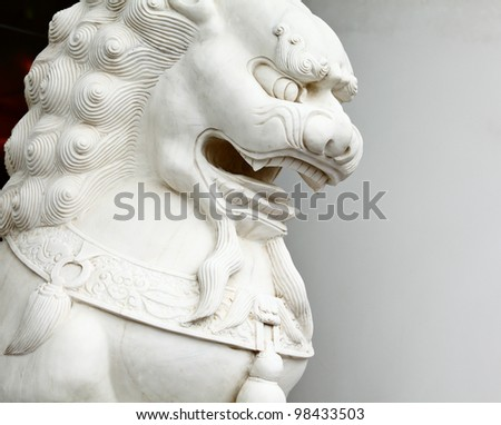 Chinese lion statue close up - stock photo