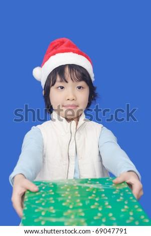 Chinese little kid sending Christmas gift - stock photo